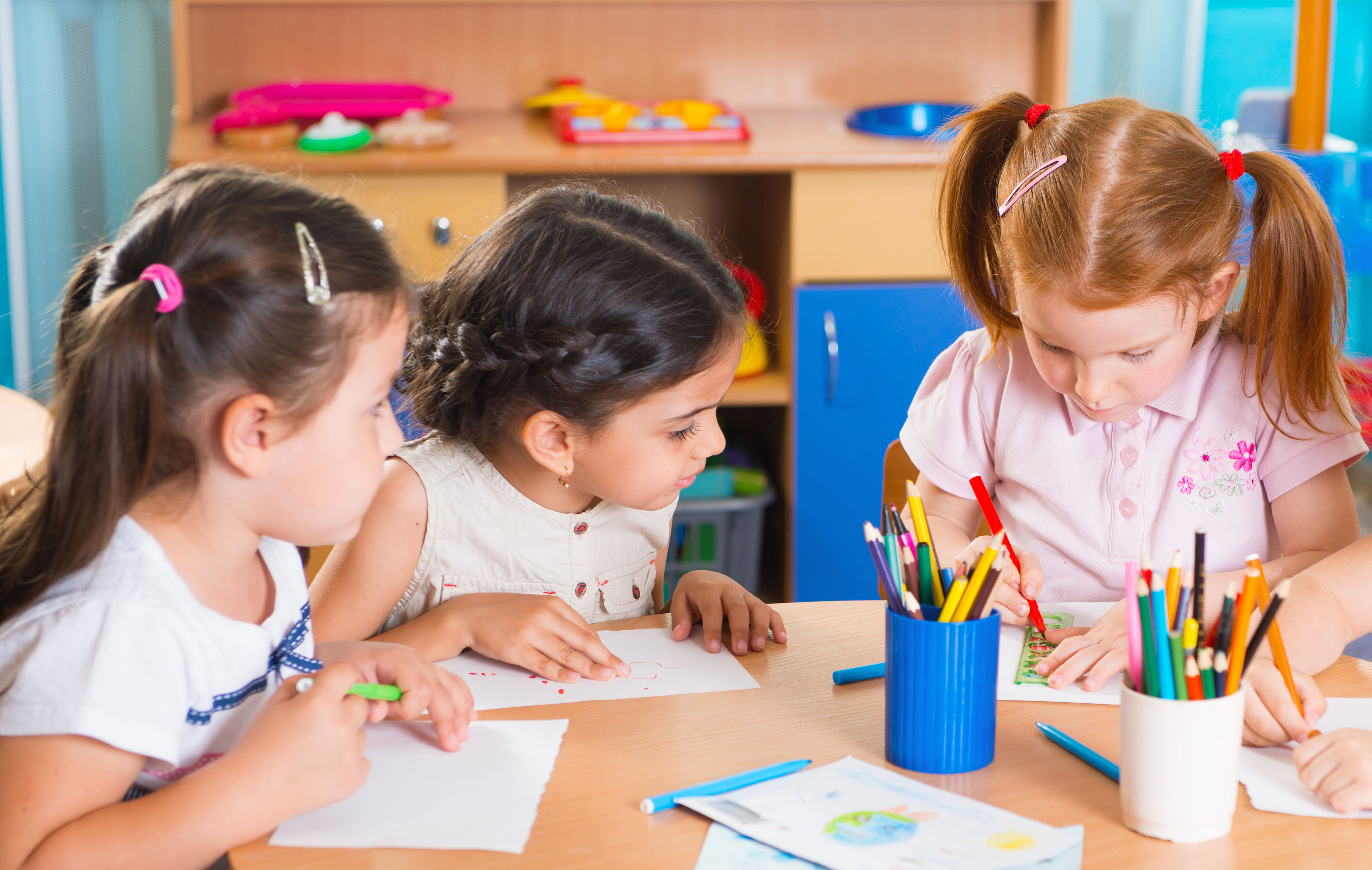 Group of cute little preschool kids drawing with colorful pencils; Shutterstock ID 153854864; PO: Zeus